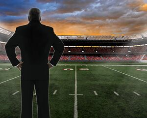 Man standing by football field