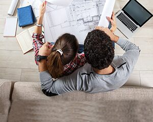 Couple reviewing home schematics