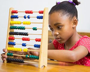 preschooler with abacus