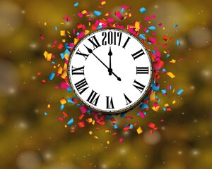 clock with confetti surrounding it