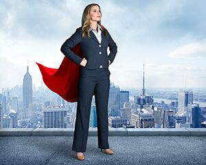 woman in a suit with a superhero cape