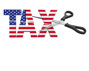 "word ""tax"" with a pair of scissors cutting it"